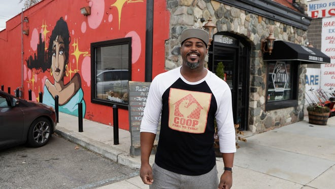 "In a photo from Friday, Nov. 17, 2017, River Bistro chef Maxcel Hardy stands outside his restaurant in Detroit. Hardy plans to open another restaurant, Coop Detroit, in January in Midtown. He is a Detroit native and has partnered with restaurants in places like Harlem and Miami. ""Detroit truly is a community and family-based,"" he said. ""Everyone says it's a 'small big city.' For chefs, it's really hot. There's a new synergy and energy in the city. The city never has been known as a food Mecca. Now, it's a revolving culinary community."""