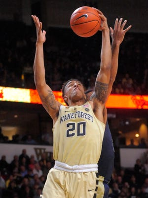 Wake Forest's John Collins gets a defensive rebound against Pittsburgh during a game in Winston-Salem, N.C. on Feb. 22, 2017.
