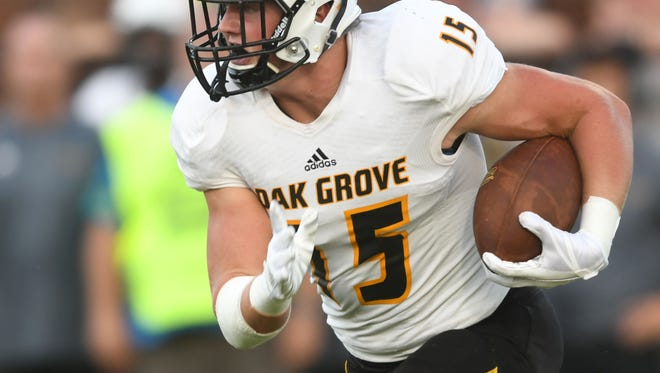 Oak Grove High School defensive end Jack Harris takes the ball down the field in a game against Purvis on Friday.