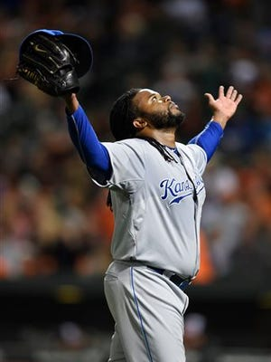 Kansas City Royals starting pitcher Johnny Cueto reacts as he walks off the field after getting the third out against the Baltimore Orioles in the fifth inning inning of a baseball game, Sunday, Sept. 13, 2015, in Baltimore. (AP Photo/Gail Burton)