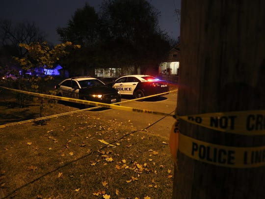 Springfield Police investigate a homicide in the 2100 block of North East Avenue in October.