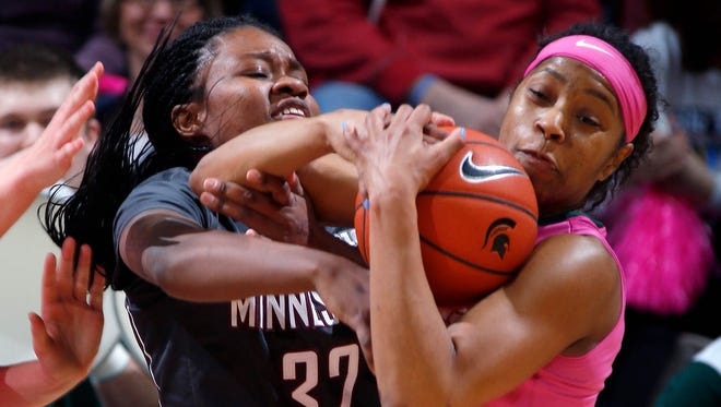 Michigan State's Branndais Agee, right, rips the ball away from Minnesota's Karley Barnes Sunday, Feb. 21, 2016, in East Lansing, Mich. Michigan State won 114-106.