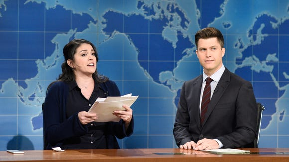 Cecily Strong as Claire from human resources does a sketch with Colin Jost during 'Weekend Update.'