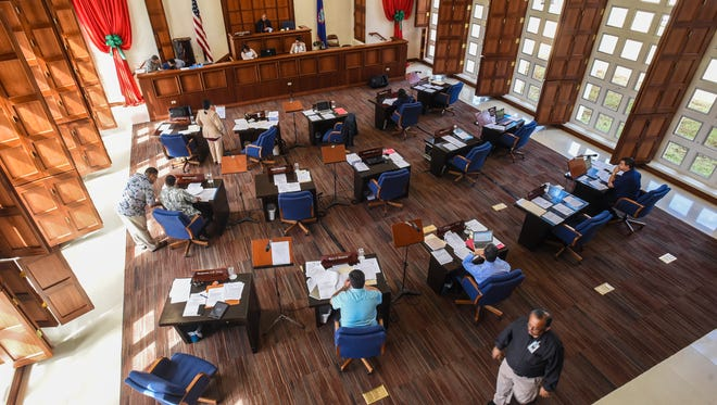 A few lawmakers are seen on the session floor at the Guam Legislature in Hagåtña in this Dec. 28, 2016, file photo.