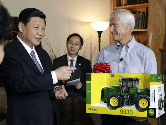 Rick Kimberley presents a model tractor to Chinese