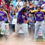DeSoto Central's Dallas Woolfolk (33) and Austin Riley (35) celebrate a run scored by teammate Brant Blaylock (5) against Oak Grove during MHSAA 6A Championship Baseball held Thursday at Trustmark Park in Pearl.