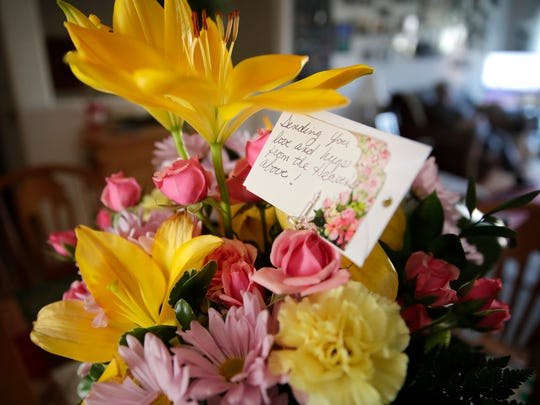 Flowers from a family friend with the inscription,