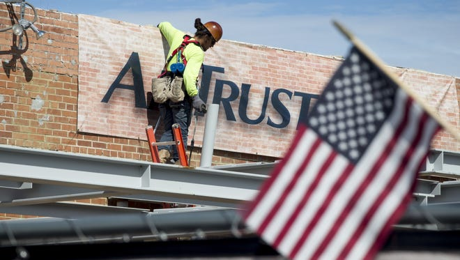 Jacob Lopez works above AmTrust Bank, October 21, 2015, at the Uptown Plaza, Central Ave. and Camelback Road, Phoenix.