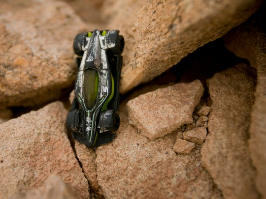 A toy car lies on the ground at an abandoned uranium mine in Cameron, an indication that children have been playing near the contaminated site in Navajo Reservation.