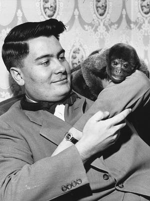 """There was no hint of the tragic legacy Jim Jones would leave behind in a remote South American colony when, in Dec. 1953, he playfully posed with """"Sugar"""" one of the monkeys an Indianapolis church sold to raise building funds. Jones started out as a student pastor at Somerset Christian Assembly in June 1952."""