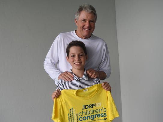 Lucas Lye, 12, and his dad, Mark Lye, 64, stand at