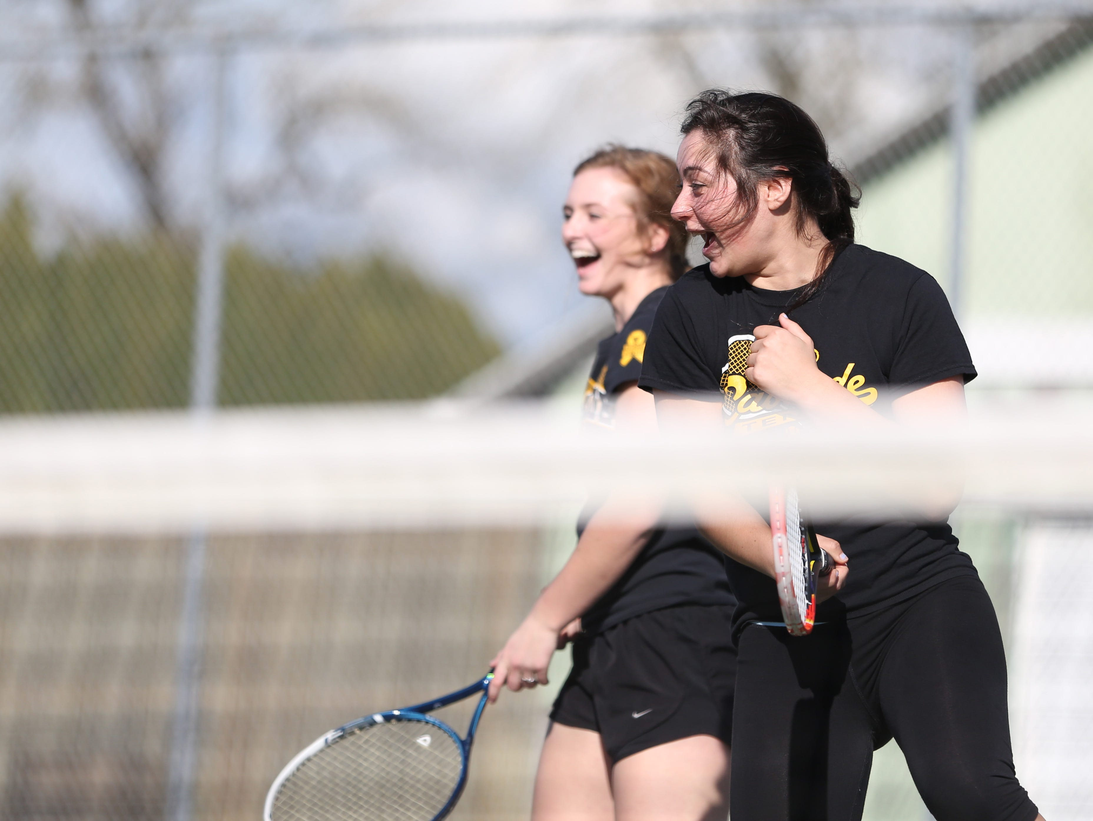 Doubles team Tori Lewis, left, and Jaja Osuna Sola practice on Tuesday, March 21, 2017, at Cascade High School in Turner.