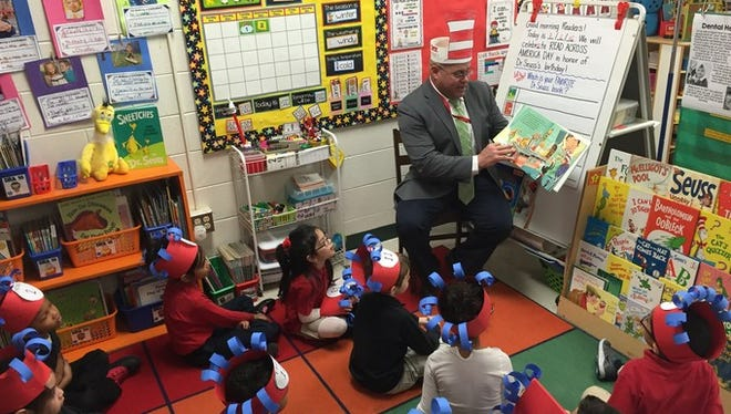 Haledon Public School students enjoy a good book with Dr. Miguel Hernandez, superintendent, on Read Across America Day in March. The students are first-graders in Carly Saal's class.