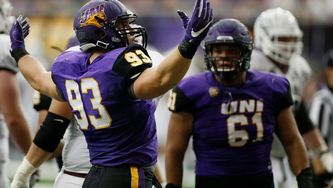 Northern Iowa's Karter Schult celebrates sacking Montana quarterback Brady Gustafson (not pictured) in the first half of a game in the UNI-Dome Sept. 10.