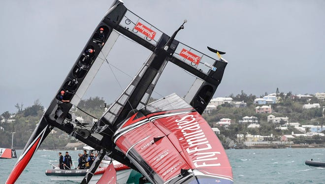 In this photo provided by America's Cup Event Authority, Emirates Team New Zealand capsizes during an America's Cup challenger semifinal against Great Britain's Land Rover BAR on the Great Sound in Bermuda on June 6.