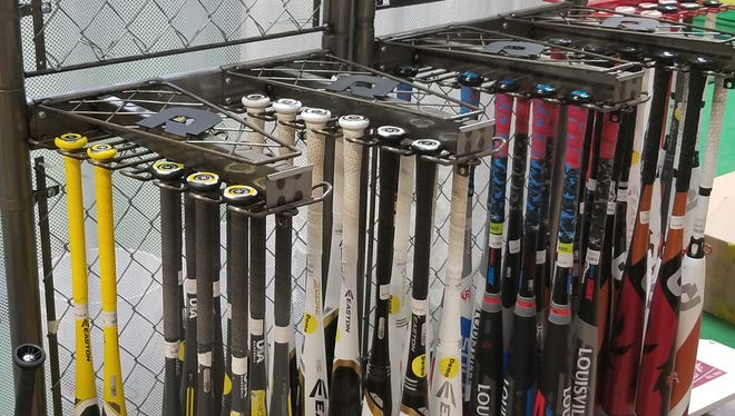 Golf Plus, located on Evansville's east side, provides customers with a demo room to test out baseball bats before purchasing.