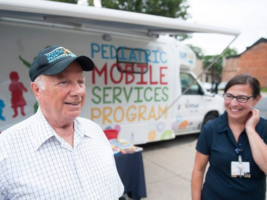 Sam Lacroce, left, President of the Joseph Lacroce Foundation, and Maria Emerson, Director of Virtua's Pediatric Early Intervention Program, stand in front of Virtua's Pediatric Mobile Services Program unit in Camden on Wednesday, June 27, 2018.  Emerson had the idea of Virtua's Pediatric Mobile Services Program unit and Lacroce donated one million dollars to the program.