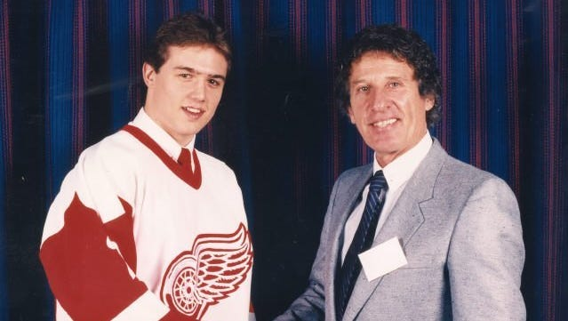 A young Steve Yzerman and Red Wings owner Mike Ilitch shake hands in a 1983 photo from Yzerman's rookie year with the Wings.