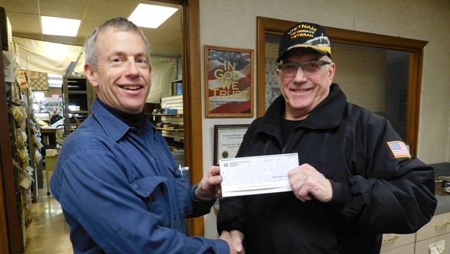 Manitowoc Motor Machining and Parts owner Scott Wichlacz, left, recently presented a check to Manitowoc County United Veterans Council chairman Tom Hoffman. The money - raised by Manitowoc Motor Machining and Parts employees and matched by Wichlacz - will be used for needy veterans and to help maintain wheel chairs, scooters and other equipment that the MCUVC lends for free to veterans, as well as maintaining the eternal flame and veterans monuments on North 18th Street.