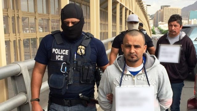 Two men, Luis Angel Romo, foreground, and Fidel Muñoz-Gomez, right, wanted in Mexico on unrelated murder charges were turned over Thursday by U.S. Immigration and Customs Enforcement officers to Mexican authorities at the Stanton Street Port of Entry.