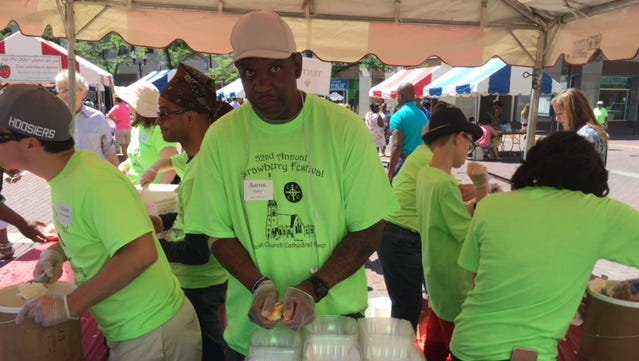 Aaron Bailey, center, volunteers at the 2017 Christ Church Cathedral Women's Strawberry Festival. Bailey was fatally shot by two Indianapolis police officers early June 29, 2017, following a traffic stop and short car chase. A later search of the car revealed he was unarmed.
