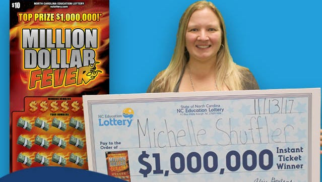 Michelle Shuffler with her $1 million check. Shuffler won the lottery twice on Sunday.
