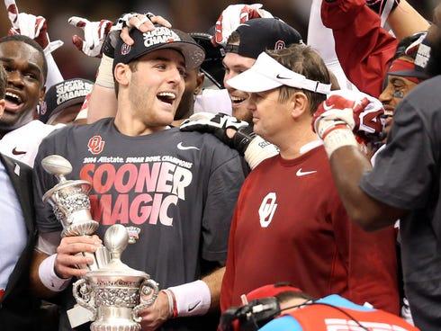 Oklahoma quarterback Trevor Knight, left, and coach Bob Stoops celebrate their Sugar Bowl victory over Alabama.