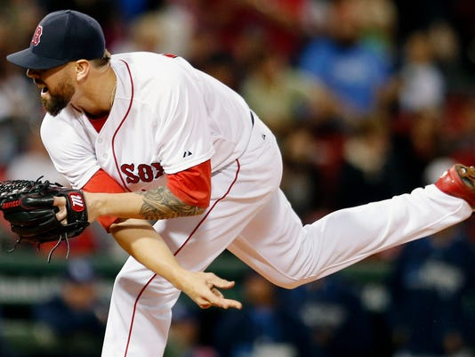 Boston Red Sox's Anthony Ranaudo follows through on a pitch during the first inning of a baseball game against the Tampa Bay Rays in Boston, Wednesday, Sept. 24, 2014. (AP Photo/Michael Dwyer)