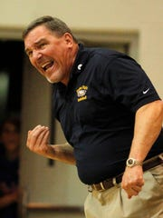 Naples girls basketball head coach Dave Walker on the sideline of a game on Feb. 13, 2010. Walker won 611 games as the Eagles' coach from 1979-2012.