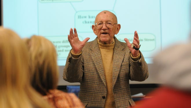 """Clarence """"Inky"""" Jungwirth, 93, speaks to University of Wisconsin-Oshkosh Professor Ava McCall's social studies methods class about Oshkosh's history and capturing its essence in this 2012 file photo. He wrote many publications and books and gave more than 400 lectures on history."""