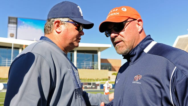 UTEP head coach Sean Kugler, right, talks with Rice head coach David Bailiff after UTEP's 44-24 loss to Rice in an NCAA college football game, Saturday, Nov. 19, 2016, in Houston.