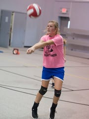 A player on the Ross County Christian Academy Volleyball team hits a ball that is served to her during practice.