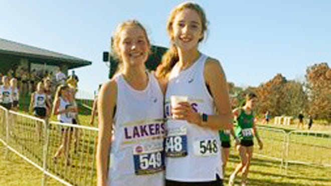 Camdenton's Cambrie Kowal (left) and Madelyn Coffelt (right) at the Class 4 state cross country meet at Gans Creek in Columbia.