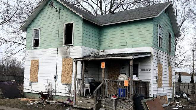 Three people died Saturday night when a blaze erupted in this single-family house on Home Street in Elmira.