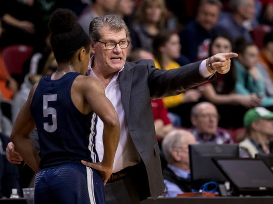 Connecticut's head coach Geno Auriemma, right, instructs Crystal Dangerfield, left, during the first half of an NCAA basketball game against Temple, Sunday, Jan. 21, 2018, in Philadelphia. Connecticut won 113-57. (AP Photo/Chris Szagola)