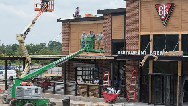 BJ's Restaurant and Brewhouse is rising quickly and is set to open Aug. 27 on the site of the former Chammps sports bar.