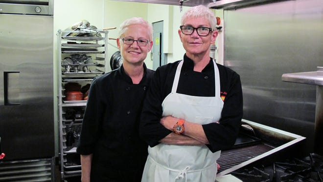 Mary Shipman, left, and Isabel Pozo Polo pose in the kitchen of IM Tapas on May 18, 2018, the day before they closed the restaurant they owned and operated in Naples for more than 10 years.