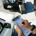 A police officer writing a ticket