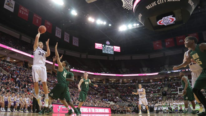 Lexington's Cade Stover makes a shot during state division II basketball semifinals against Akron St. Vincent-St. Mary in 2018 at the Schottenstein Center on the campus of The Ohio State University. In 2020, the girls state finals will move to St. John Arena with the boys to follow in 2021.