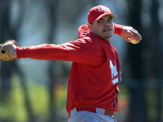 Alex Perez pitches for Perth Amboy High School in 2000