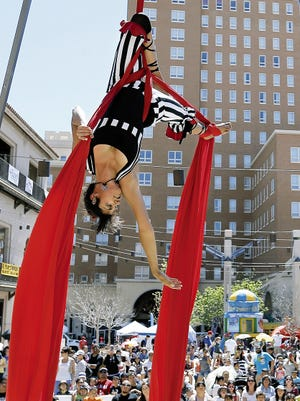 An aerial dancer performs at last year's Downtown KidsPalooza. The family arts and music festival returns on Saturday.