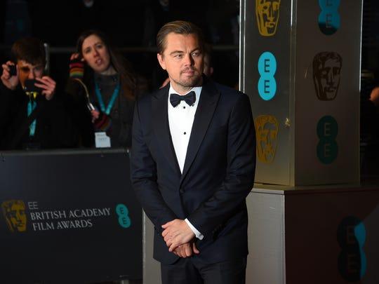 Actor Leonardo Di Caprio poses for photographers upon