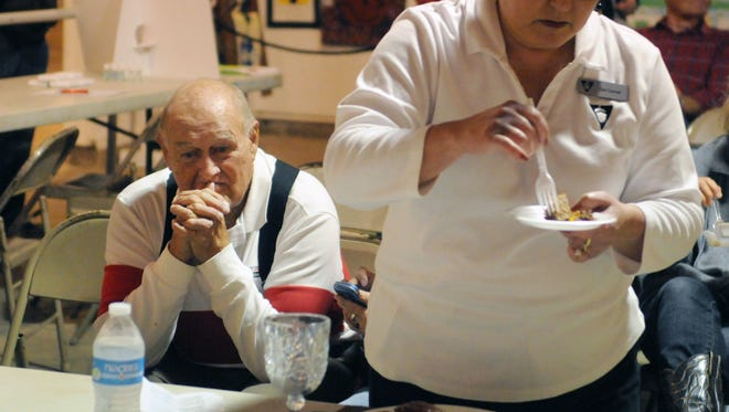 Bill Weaver waits while Dee Conrad, judge, tastes his dish during the beef cook off Wednesday morning at the Fairfield County Fair.