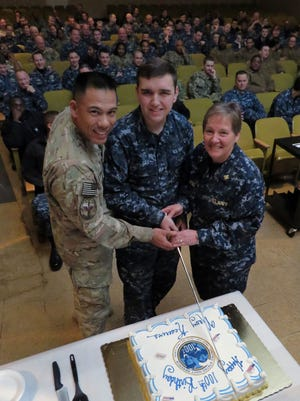Navy Operational Support Center Pensacola personnel celebrated the 100th anniversary of the Navy Reserves Saturday by cutting a special cake in honor of the anniversary. RADM Valerie Huegel has been in the service for over 30 years and she is shown cutting the cake with the newest member of their support center, YNSR James Gill who has been in the Navy nine months. Also pictured with them, far left, is CDR Tony Bayungan, NOS Saufley Field.