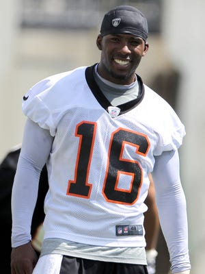Cincinnati Bengals wide receiver Andrew Hawkins (16) smiles as he looks on as the team stretches during Minicamp at Paul Brown Stadium Tuesday June 12, 2012.