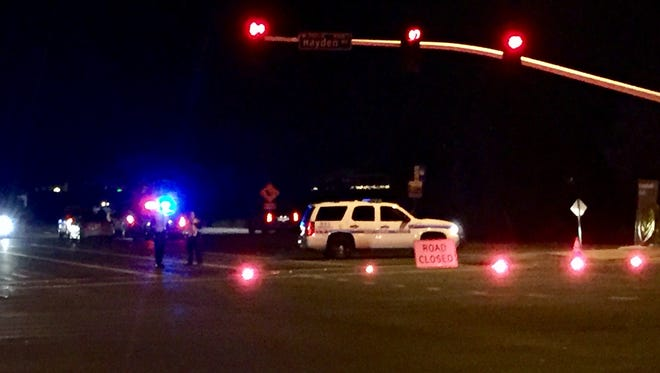 The scene Sunday, Dec. 18, near Hayden and Chaparral roads in Scottsdale, where police say an officer was involved in a shooting.