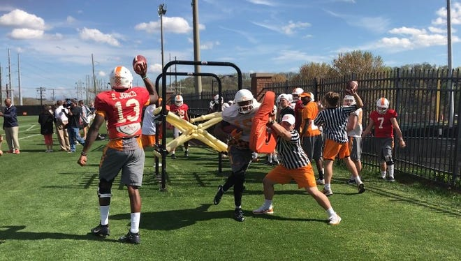 Tennessee student manager Chris Cole endures a hit from wide receiver Jauan Jennings during spring practice on Tuesday at Haslam Field.