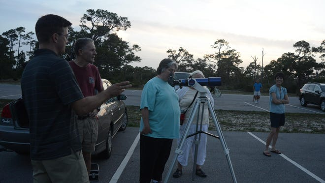 Stargazers gather at Fort Pickens to take in the view of the distant summer sky.