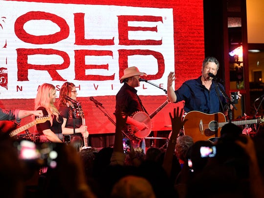 Blake Shelton performs during the grand opening of