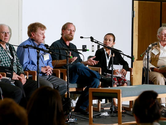 Steve Austin with the Navajo Nation Environmental Protection Agency, center, takes part in a discussion about the environmental conditions of the Animas and San Juan watersheds on Wednesday at the Henderson Fine Arts Building at San Juan College.